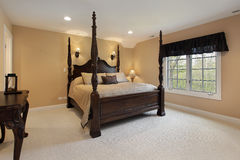 Master bedroom with gold walls royalty free stock image