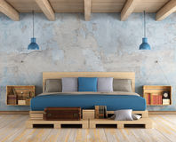 Master bedroom in a grunge room Royalty Free Stock Image