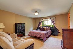 Master bedroom interior with purple queen size bed. Northwest, USA royalty free stock photo
