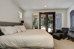 Master bedroom interior with queen size bed Royalty Free Stock Photo