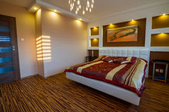 Master bedroom interior with spotlights Stock Images