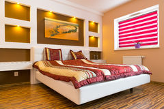 Master bedroom interior with white bed Stock Photo