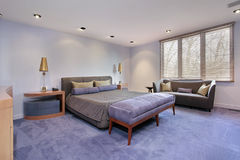 Master bedroom with lavendar carpeting. Master bedroom in luxury home with lavendar carpeting Royalty Free Stock Images