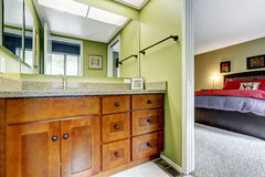 Master bedroom with light green tone bathroom Royalty Free Stock Photography