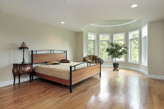 Master bedroom in luxury home. With curved windows Royalty Free Stock Images