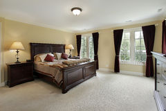 Master bedroom with mahogany furniture Royalty Free Stock Photography