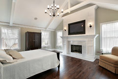 Master bedroom with marble fireplace Stock Photos