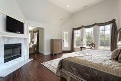 Master bedroom with marble fireplace Stock Photo