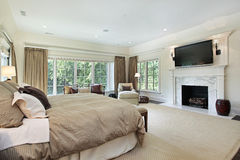 Master bedroom with marble fireplace Royalty Free Stock Photography