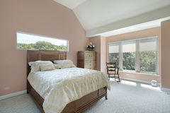 Master bedroom with mauve colored walls Stock Image