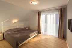 Master bedroom in new house. Master bedroom interior in new house royalty free stock photography