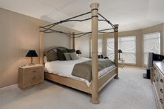 Master bedroom with oak wood bed frame Royalty Free Stock Photos