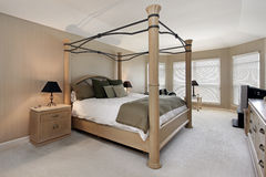 Master bedroom with oak wood bed frame Royalty Free Stock Photo
