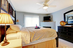 Master bedroom with queen size bed. Light blue master bedroom with queen size bed and vanity cabinet stock photos