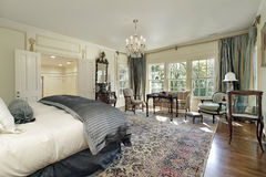 Master bedroom with sitting room royalty free stock image