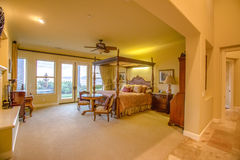 Master bedroom in spacious home Royalty Free Stock Image