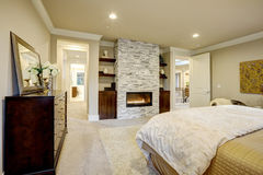 Master bedroom with stone fireplace Stock Image