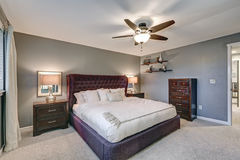 Master bedroom suite with gorgeous queen size bed Royalty Free Stock Images