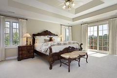 Master bedroom with tray ceiling Royalty Free Stock Photos