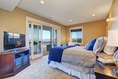 Master bedroom with walkout deck Stock Image