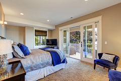 Master bedroom with walkout deck Royalty Free Stock Image