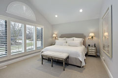 Master bedroom with wall of windows Royalty Free Stock Image