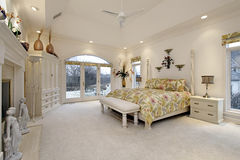 Master bedroom with white fireplace Royalty Free Stock Image