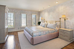 Master bedroom with wood floors Royalty Free Stock Photos