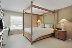 Master bedroom with wood frame Stock Images