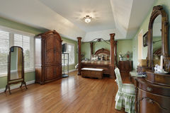 Master bedroom with wood framed bed Royalty Free Stock Photos