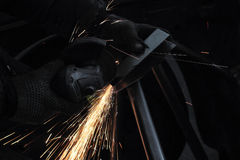 The master behind work. Angle grinder Stock Photography