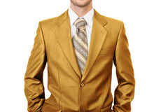 Master of business dressed in gold suit Stock Photos