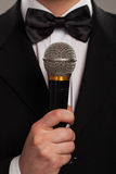 Master of ceremonies with microphone Stock Images