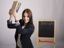 Master cheerfully raised over the head of textbooks. Portrait Royalty Free Stock Images