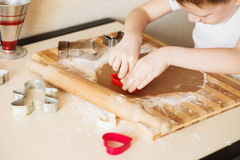 Master class for children on baking christmas cookies. Young chi Royalty Free Stock Photo