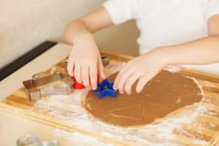 Master class for children on baking christmas cookies. Young chi Stock Photos