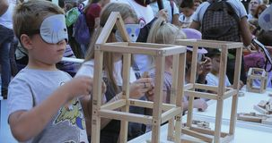 Master class on the creation of wooden figures. RUSSIA, MOSCOW - September 08, 2018: Master class on the creation of wooden figures. During the celebration of stock video footage