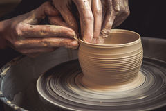 Master class on modeling of clay on a potter`s wheel stock photo