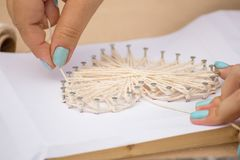 Master class in the park. How to make a picture of threads. And nails royalty free stock photo