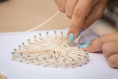 Master class in the park. How to make a picture of threads. And nails stock photos