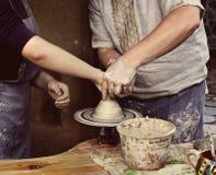 The master class of pottery art. Woman creating a bowl on a Potter's wheel, the master class of pottery art Stock Photos