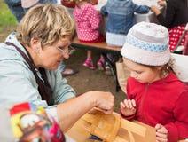 Master class teaching children folk crafts weaving a basket Royalty Free Stock Photos
