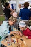 Master class teaching children folk crafts weaving a basket Stock Photo