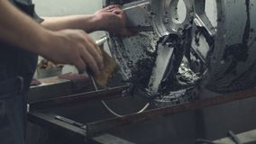 Master cleans the car disk from the old paint stock video footage