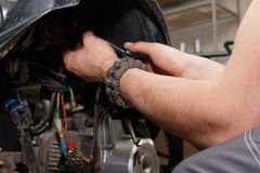 The master conducts disassembly of equipment for maintenance royalty free stock photography