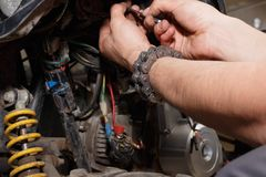 The master conducts disassembly of equipment for maintenance royalty free stock photo
