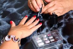 Master covers the nails with gel Royalty Free Stock Photo