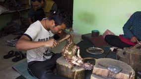 The master in creation of Buddhist bronze statues at work. The master in creation of traditional Buddhist bronze statues at work. Knocks the hammer and blows stock video