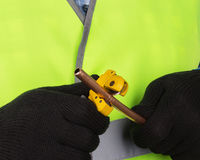 Master cutting a copper pipe with a pipe cutter Royalty Free Stock Photos