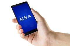 Master dell'amministrazione aziendale o della parola di MBA sullo Smart Phone Fotografia Stock Libera da Diritti